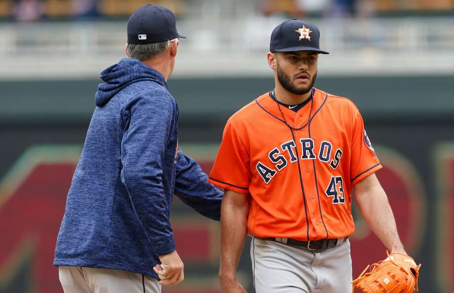 Houston Astros pitcher Lance McCullers Jr., right, gets a pat on the back from manager A.J. Hinch as he is pulled in the fourth inning of a baseball game after giving up a two-run home run to Minnesota Twins' Max Kepler Wednesday, April 11, 2018, in Minneapolis. (AP Photo/Jim Mone) Photo: Jim Mone/Associated Press