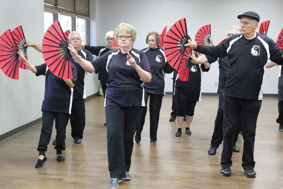 Members of The Woodlands Tai Chi Practice Group move through synchronized steps during tai chi practice on Tuesday, April 10, at the South Regional Community Center. The group invites the public to practice on Saturday, April 28, at Creekside Park Village Green for World Tai Chi Day. Photo: Staff Photo By Patricia Dillon / Staff Photo By Patricia Dillon