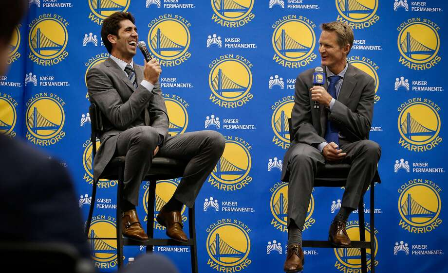 Team general manager Bob Myers, (left) and new the Golden State Warriors head coach Steve Kerr, share a laugh during a press conference at their training facility in Oakland, Calif., on Tuesday May 20, 2014. Photo: Michael Macor / The Chronicle