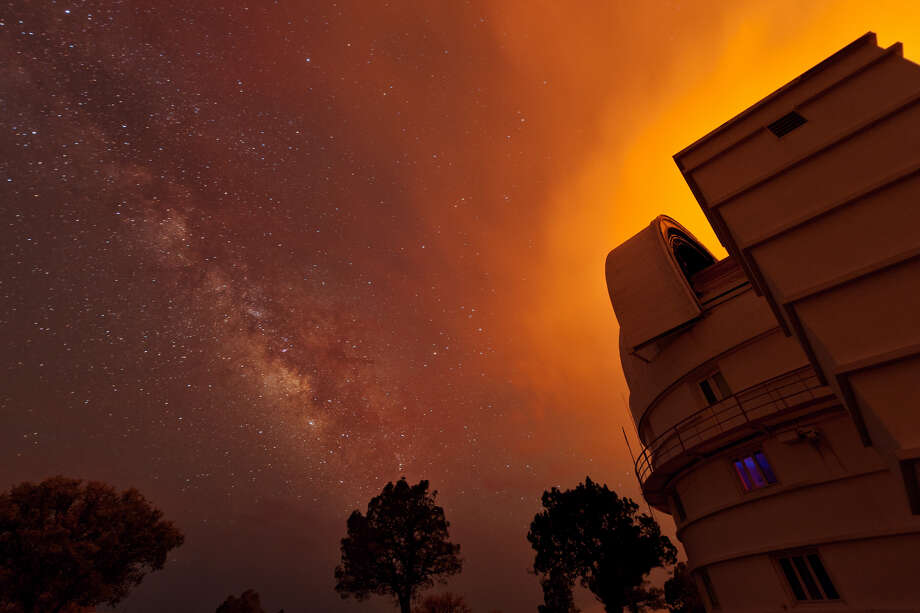 Glow from artificial lights at night can hamper efforts by the McDonald Observatory and other Earth-based telescopes to observe the skies. Photo: Neutronman / Getty Images