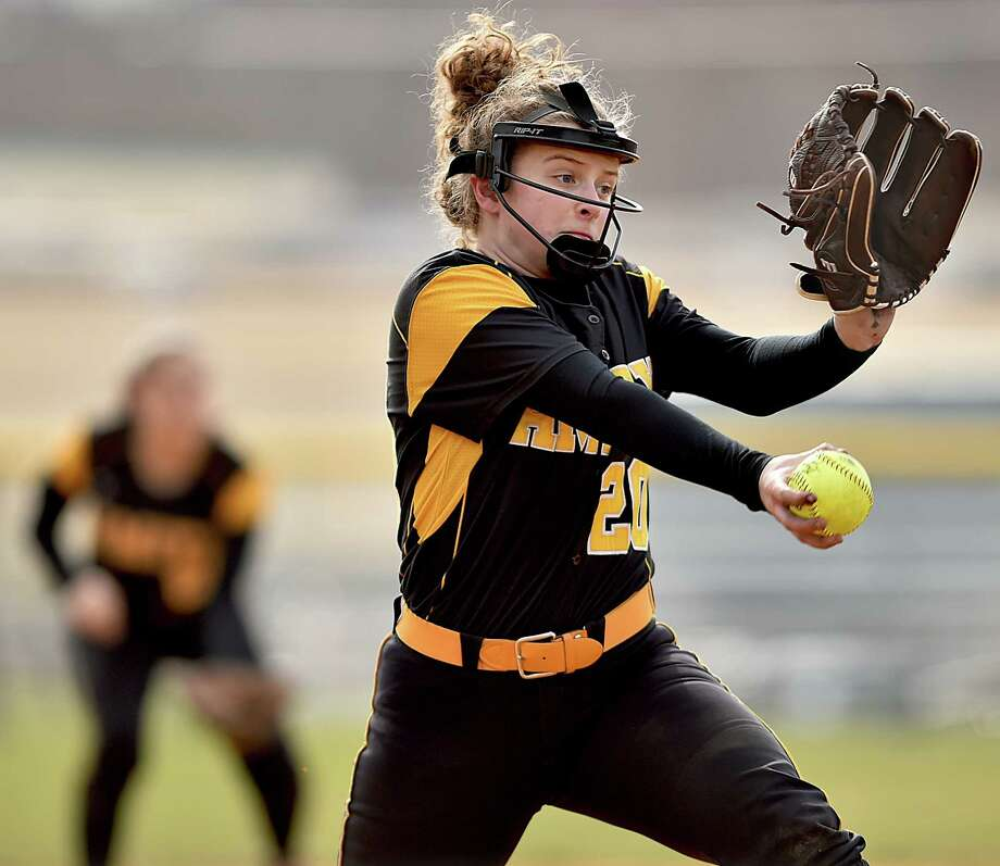 Amity sophomore Abigail Fletcher delivers a pitch against Lauralton Hall, Wednesday, April 11, 2018, at Amity High School in Woodbridge. Amity won, 6-1. Photo: Catherine Avalone, Hearst Connecticut Media / New Haven Register