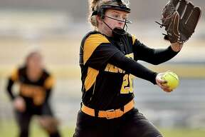 Amity sophomore Abigail Fletcher delivers a pitch against Lauralton Hall, Wednesday, April 11, 2018, at Amity High School in Woodbridge. Amity won, 6-1.