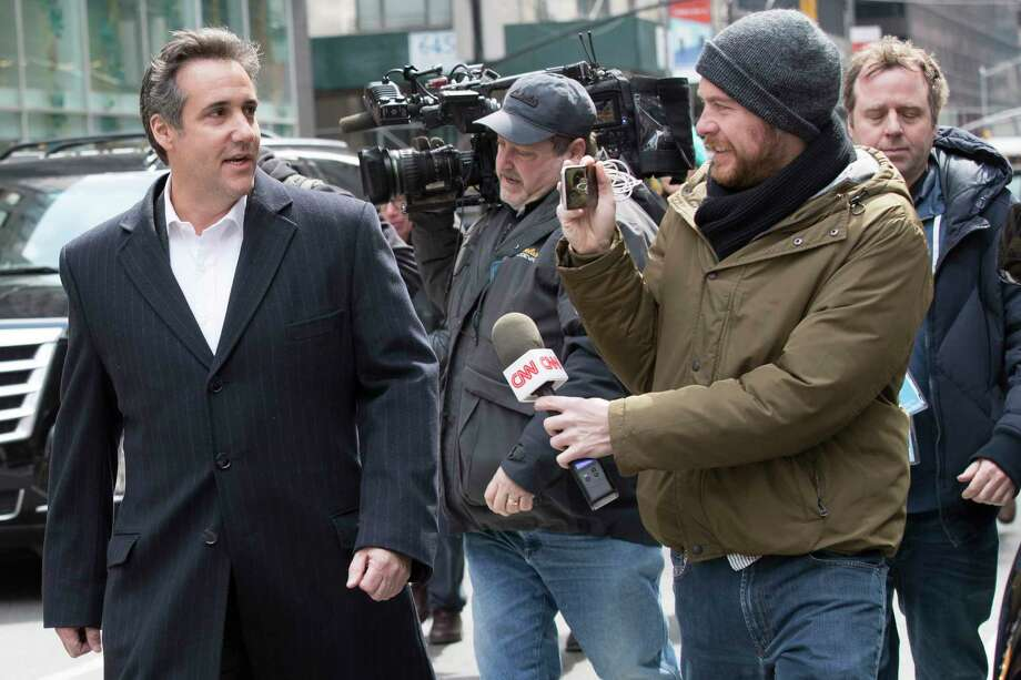 Attorney Michael Cohen, left, talks to CNN freelance producer Wes Bruer as he walks in New York, Wednesday, April 11, 2018. Federal agents who raided the office of President Donald Trump's personal attorney, were looking for information about payments to a former Playboy playmate and a porn actress who claim to have had affairs with Trump, two people familiar with the investigation said. (AP Photo/Mary Altaffer) Photo: Mary Altaffer / Copyright 2018 The Associated Press. All rights reserved.