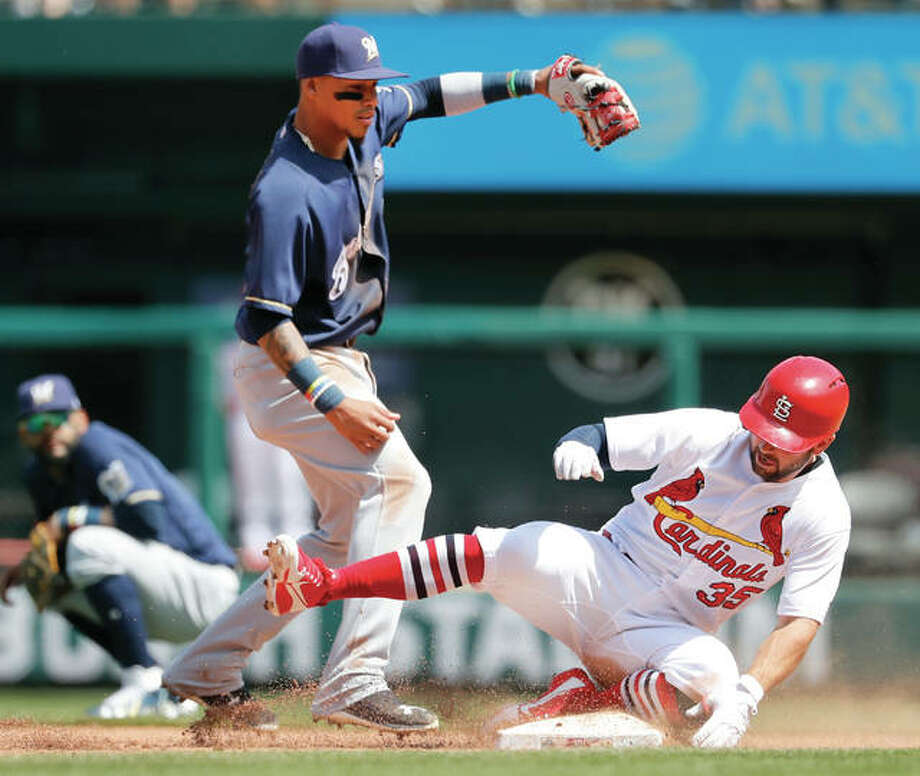 The Cardinals' Greg Garcia (right) slides safely into second base with a double as Brewers shortstop Orlando Arcia reaches for the throw during the sixth inning Wednesday at Busch Stadium. Photo:       Associated Press