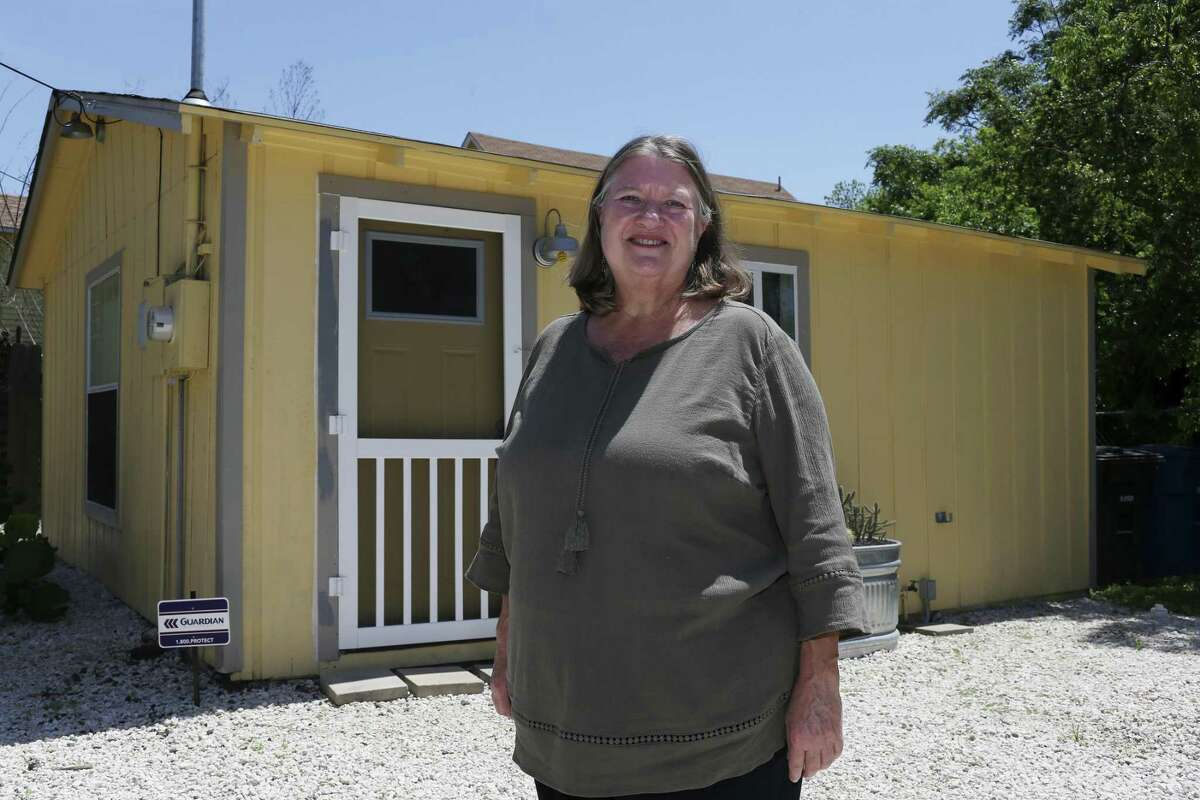 Julia Rosenfeld stands by her refurbished house in the Government Hill neighborhood, Wednesday, April 11, 2018. Rosenfeld uses the house for visits from friends and family and as a short-term rental through Airbnb. Local governments have stepped in to regulate such activity. The state Legislature will respond.