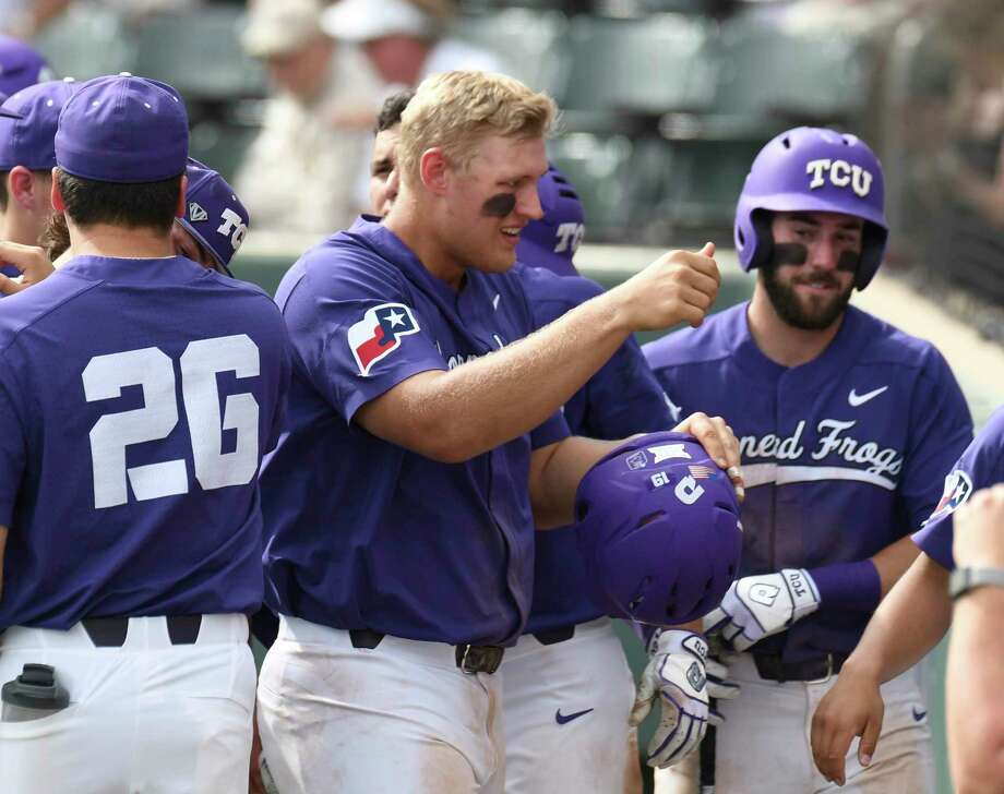 TCU's Luken Baker celebrates as he enters the dugout after hitting a solo home run against Kansas State in the seventh inning of an NCAA college baseball game Saturday, March 23, 2018, in Fort Worth, Texas. (Bob Haynes/Star-Telegram via AP) Photo: Bob Haynes, MBR / FORT WORTH STAR-TELEGRAM