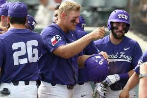 TCU's Luken Baker celebrates as he enters the dugout after hitting a solo home run against Kansas State in the seventh inning of an NCAA college baseball game Saturday, March 23, 2018, in Fort Worth, Texas. (Bob Haynes/Star-Telegram via AP)