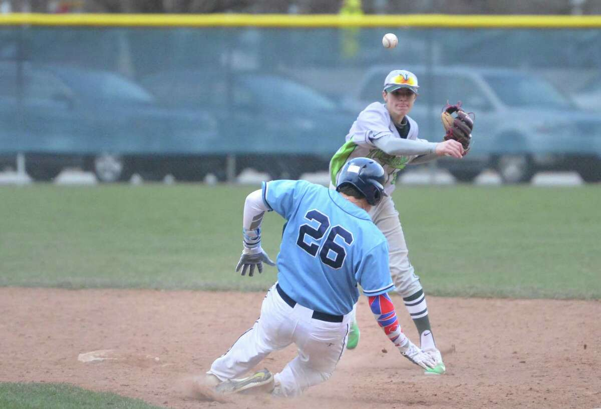 Norwalk's Michael Boylan makes the out on Wilton's Jack DiNanno at second and the throw to first base Wednesday.