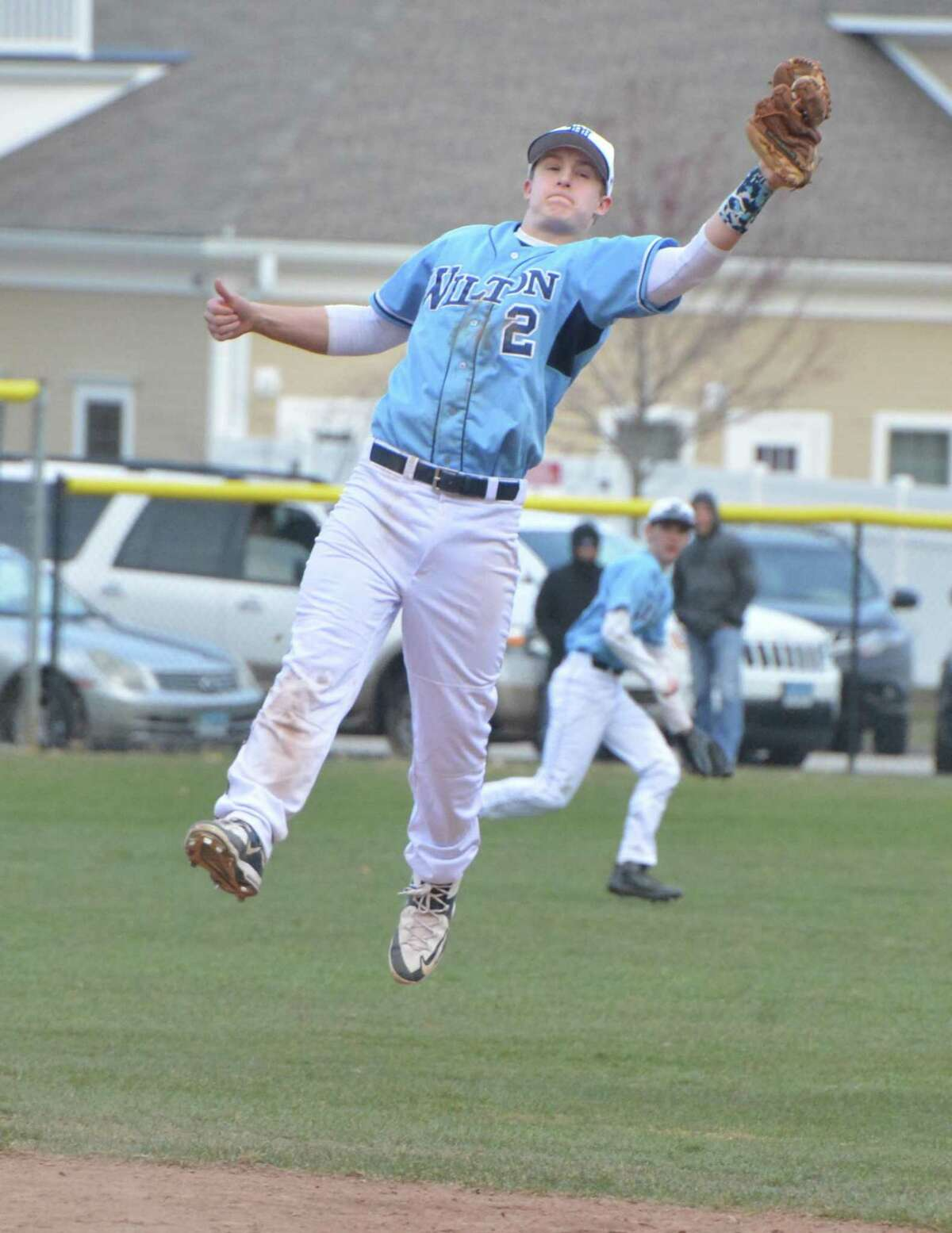Wilton's Drew Phillips makes the leap and the line-drive catch against Norwalk.