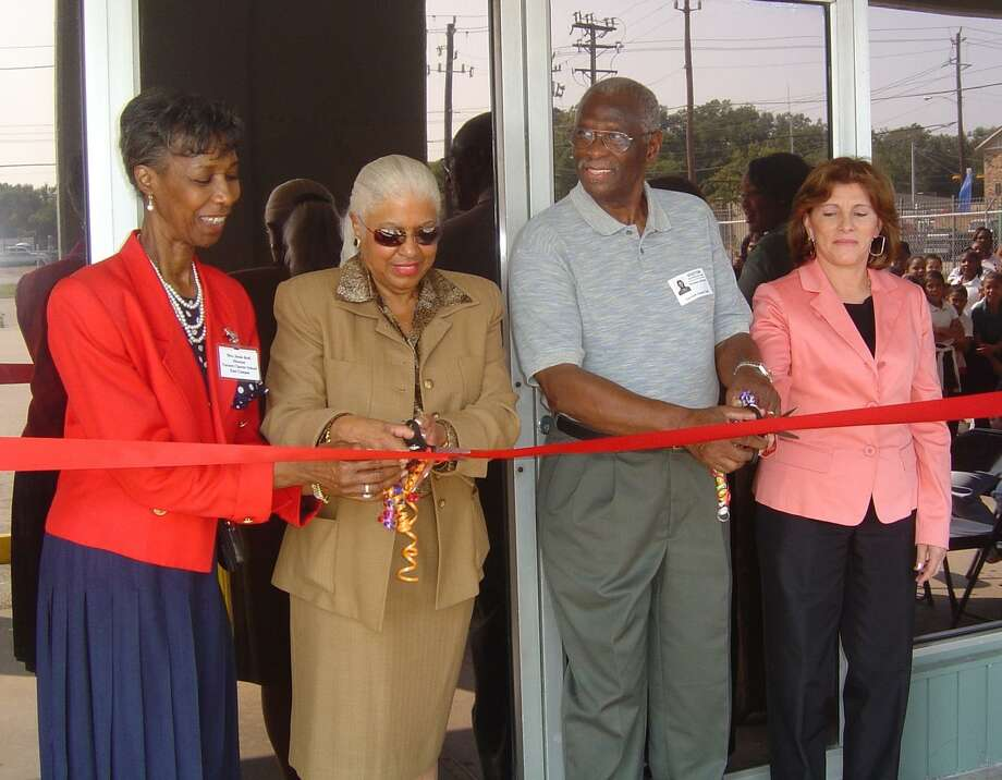 Jessie Reid, director of Varnett School's east campus location; Annette Cluff, the school's founder and superintendent,;Thomas Johnson, school board secretary; and Adiela Guzman, ESL curriculum director, cut the ribbon to open the new extension of the campus that houses a gym, library and classrooms, Photo: Varnett School / Varnett School / handout