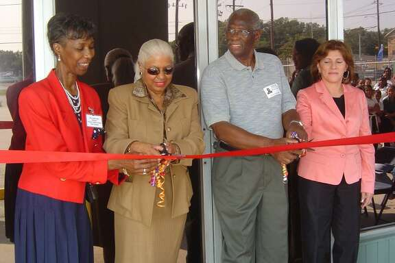 Jessie Reid, director of Varnett School's east campus location; Annette Cluff, the school's founder and superintendent,;Thomas Johnson, school board secretary; and Adiela Guzman, ESL curriculum director, cut the ribbon to open the new extension of the campus that houses a gym, library and classrooms,