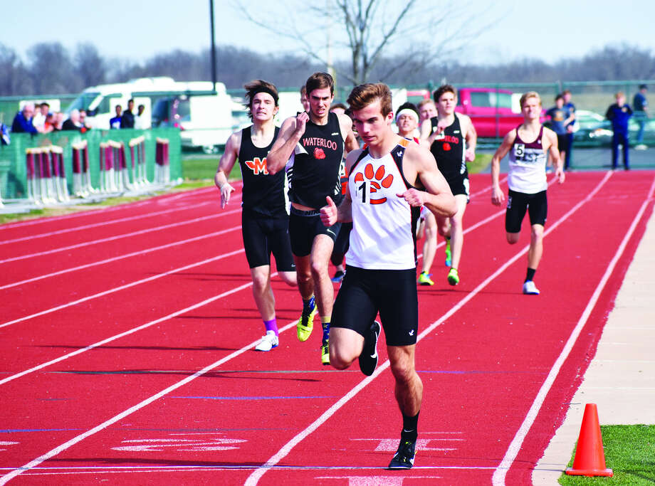 Edwardsville senior Franky Romano crosses the finish line in first place of the 800-meter run at the Belleville West Norm Armstrong Invitational on Wednesday in Belleville.