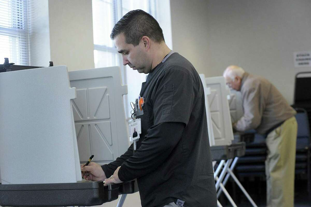 Keith Prazeres marks his ballot at the Stony Hill Fire Department polling place Wednesday, April 11, 2018. Bethel residents went to the polls Wednesday to vote in the budget referendum.