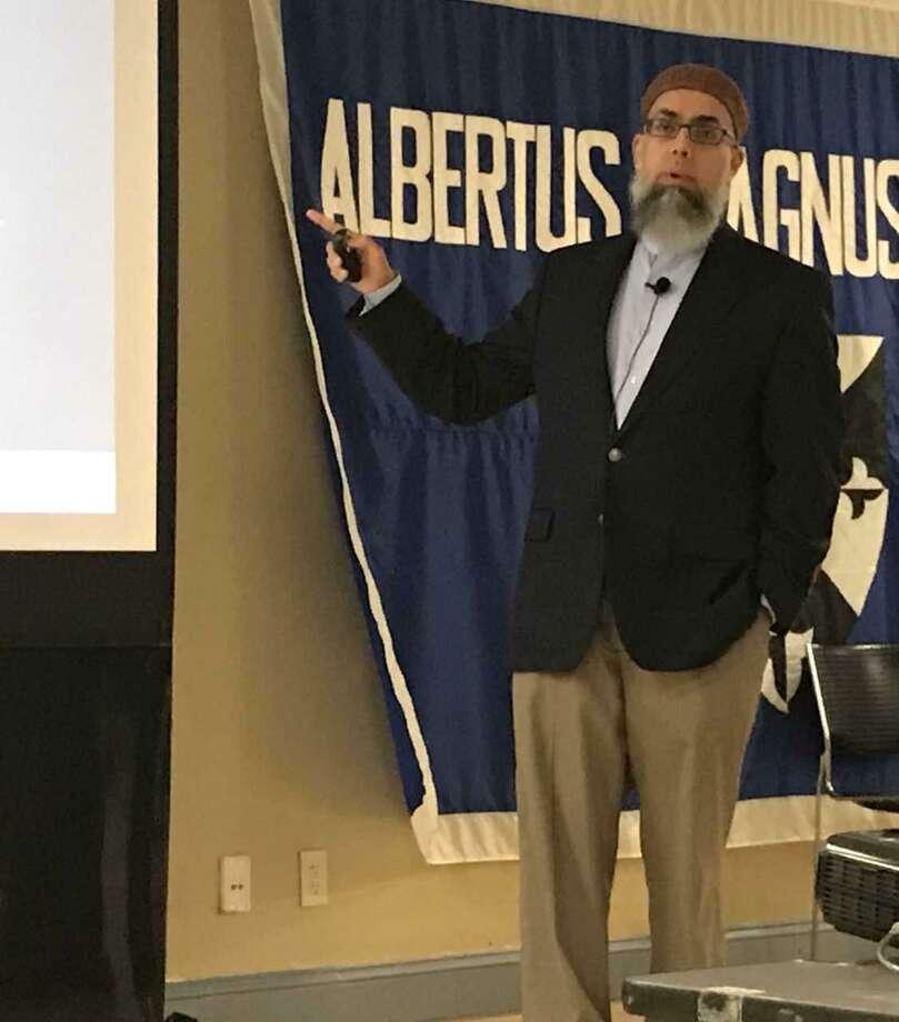 Imam Omer Bajwa speaks in New Haven Wednesday. Photo: Brian Zahn / Hearst Connecticut Media