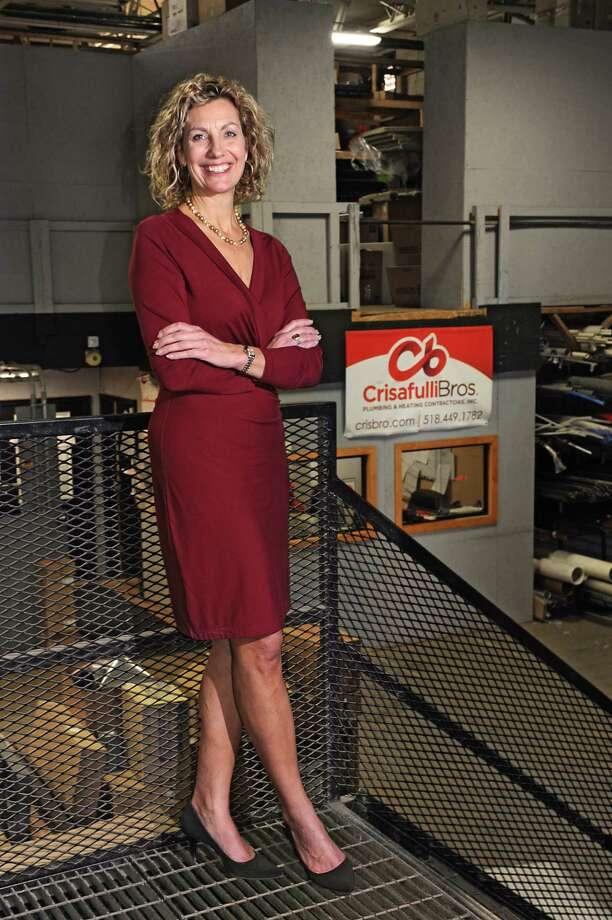 Andrea Crisafulli stands in the warehouse section at Crisafulli Bros. on Tuesday, Nov. 17, 2015 in Albany, N.Y. (Lori Van Buren / Times Union) Photo: Lori Van Buren / 00034214A