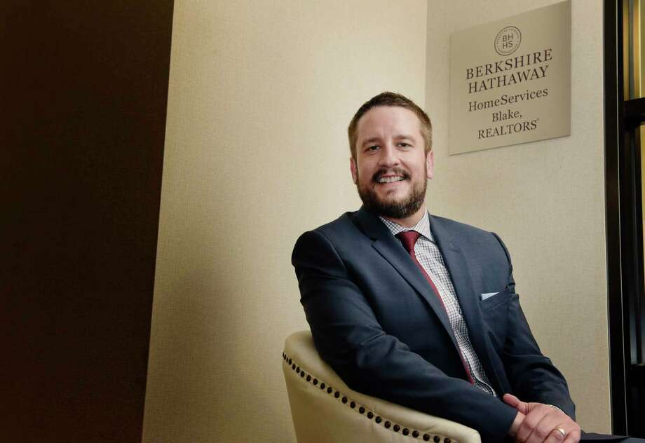 Jason Christiana, president of Berkshire Hathaway Home Services Blake Realtors, poses for a photo at his office on Tuesday, March 13, 2018, in Colonie, N.Y.    (Paul Buckowski/Times Union) Photo: PAUL BUCKOWSKI / (Paul Buckowski/Times Union)