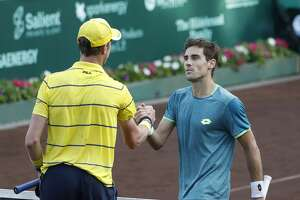 Guido Pella shakes hands with Sam Querrey after Pella won the match during the U.S. Men's Clay Court Championship at River Oaks Country Club, Wednesday, April 11, 2018, in Houston.  ( Karen Warren / Houston Chronicle )