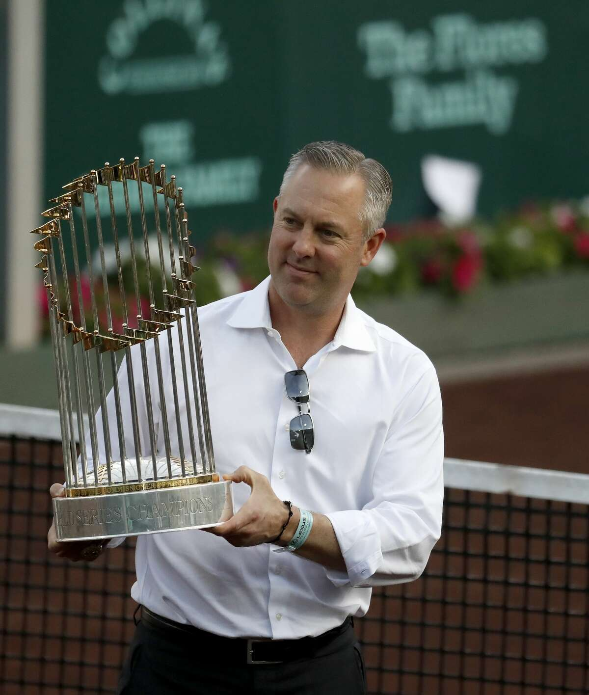 President of the Houston Astros Reid Ryan shows off the Commisoner's Trophy between matches during the U.S. Men's Clay Court Championship at River Oaks Country Club, Wednesday, April 11, 2018, in Houston. ( Karen Warren / Houston Chronicle )