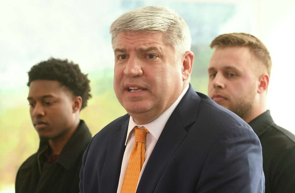 Siena men's basketball coach Jimmy Patsos holds a news conference at Lombardi, Walsh, Davenport, Amodeo law firm to address reports that he verbally abused a team manager on Friday, April 6, 2018 in Colonie, N.Y. Former team managers Wesley Douglas, left, and Robert Sherlock stand behind him. (Lori Van Buren/Times Union)
