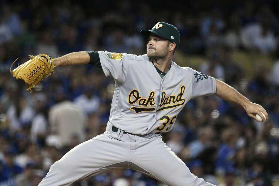 Oakland Athletics relief pitcher Daniel Coulombe throws to the plate during a baseball game against the Los Angeles Dodgers, Tuesday, April 10, 2018, in Los Angeles. (AP Photo/Michael Owen Baker) Photo: Michael Owen Baker / Associated Press
