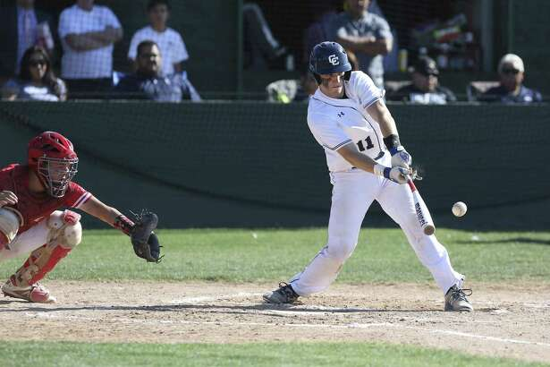 Central Catholic's Ty Williamson (11) hits a single and helps the Buttons score a run in the second inning against Antonian in TAPPS 2-I boys baseball on Wednesday, Apr. 11, 2018. The Buttons defeated the Apaches, 10-4. (Kin Man Hui/San Antonio Express-News)