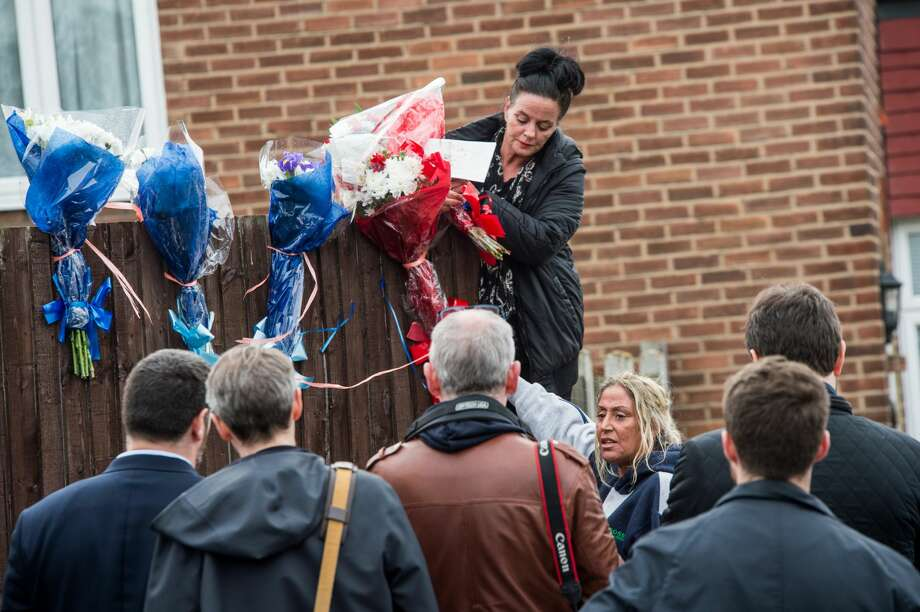 Two women are pictured bringing flowers to the makeshift shrine to Vincent opposite Mr Osborn-Brooks' home on April 10, 2018 in London, England.  Pensioner Richard Osborn-Brooks has been released without charge after he confronted a pair of burglars at his home in South East London, killing one of them. Photo: Barcroft Media/Barcroft Media Via Getty Images
