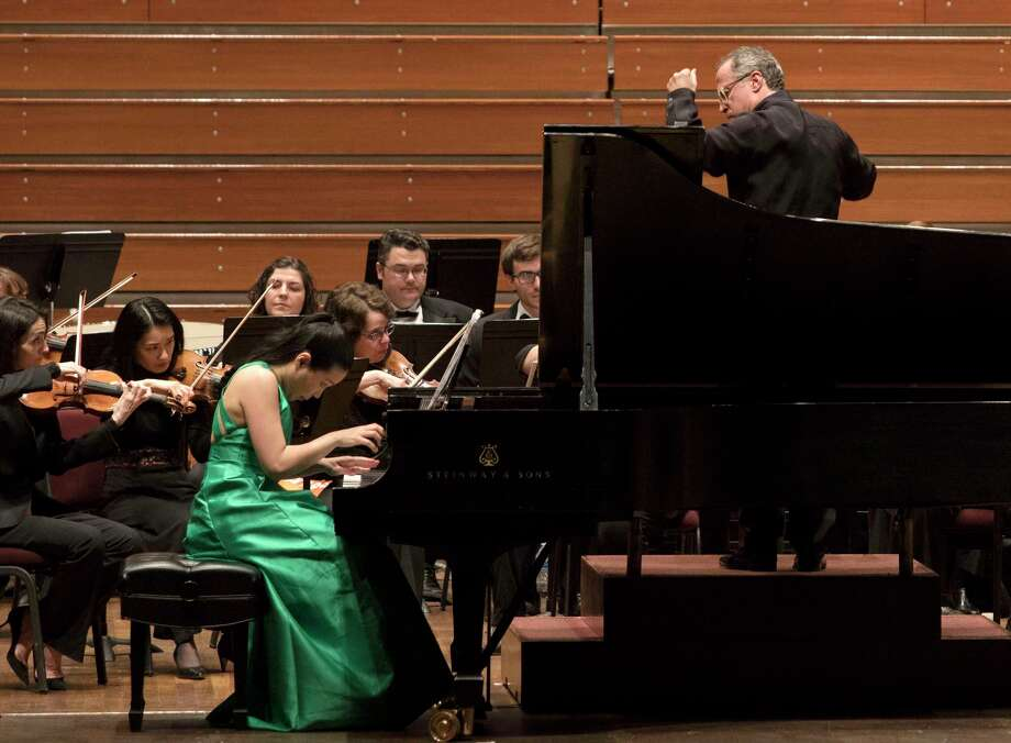 Pianist Joyce Yang, left, is led by Albany Symphony conductor David Alan Miller, right, as the symphony performed Joan TowerOs OStill/Rapids for Piano and Orchestra,O during the SHIFT Festival of American Orchestras, at the Kennedy Center on Wednesday, April 11, 2018, in Washington D.C. (Eliza Mineaux/Special to the Times Union) Photo: Eliza Mineaux