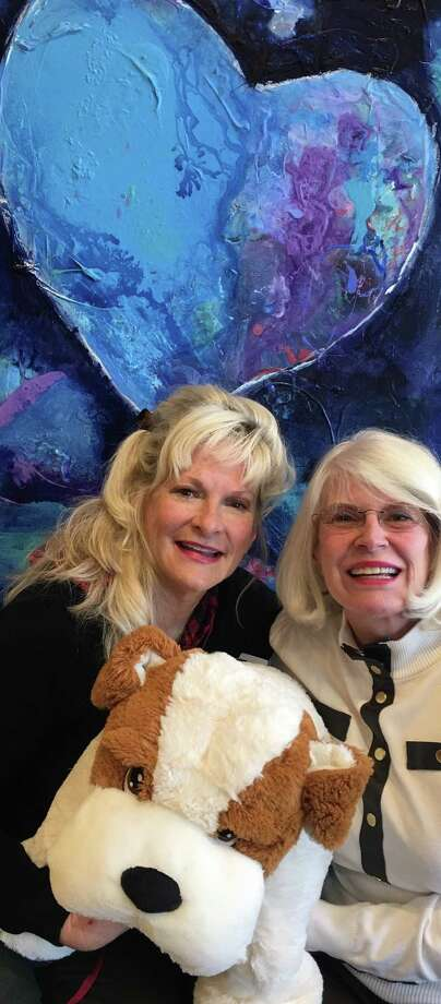"Pictured are Diane Deaton, left, and Marie Underdown, right, co-chairs of the upcoming ""Bow Wow Bingo"" on April 19 from 2 to 5 p.m. at the Conroe Art League Gallery in downtown Conroe. The event benefits SPCA PETS SNAP of Montgomery County. They are holding one of the Bingo prizes, a doggie Pillow Chum."