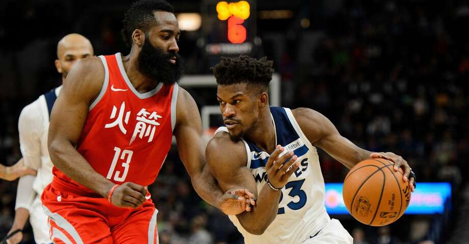 MINNEAPOLIS, MN - FEBRUARY 13: Jimmy Butler #23 of the Minnesota Timberwolves drives to the basket against James Harden #13 of the Houston Rockets during the game on February 13, 2018 at the Target Center in Minneapolis, Minnesota. NOTE TO USER: User expressly acknowledges and agrees that, by downloading and or using this Photograph, user is consenting to the terms and conditions of the Getty Images License Agreement. (Photo by Hannah Foslien/Getty Images) Photo: Hannah Foslien/Getty Images