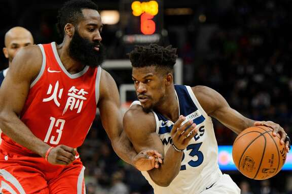 MINNEAPOLIS, MN - FEBRUARY 13: Jimmy Butler #23 of the Minnesota Timberwolves drives to the basket against James Harden #13 of the Houston Rockets during the game on February 13, 2018 at the Target Center in Minneapolis, Minnesota. NOTE TO USER: User expressly acknowledges and agrees that, by downloading and or using this Photograph, user is consenting to the terms and conditions of the Getty Images License Agreement. (Photo by Hannah Foslien/Getty Images)
