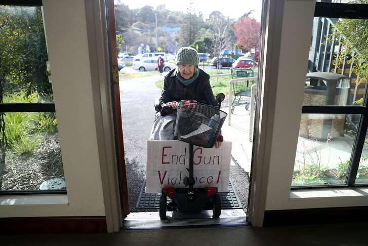 Mill Valley Seniors for Peace's Helen Anderson heads back to her apartment after the group's weekly protest outside Redwoods Retirement Community in Mill Valley, Calif., on Friday, March 16, 2018.