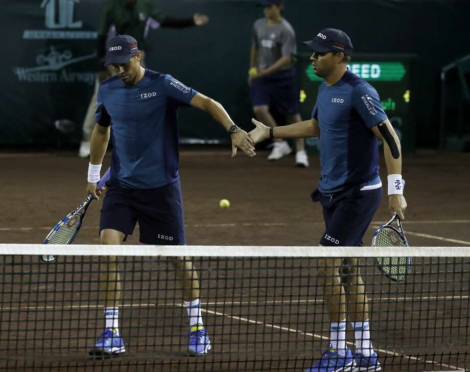 PHOTOS: Clay Court Championships Mike Bryan, left, and  his brother Bob Bryan celebrate winning a game against Taro Daniel and Yoshihito Nishioka during men's doubles in the U.S. Men's Clay Court Championship at River Oaks Country Club, Wednesday, April 11, 2018, in Houston.  ( Karen Warren / Houston Chronicle ) >>>Look back at photos from the 2018 U.S. Men's Clay Court Championship ... Photo: Karen Warren/Houston Chronicle