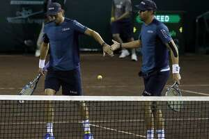 Mike Bryan, left, and  his brother Bob Bryan celebrate winning a game against Taro Daniel and Yoshihito Nishioka during men's doubles in the U.S. Men's Clay Court Championship at River Oaks Country Club, Wednesday, April 11, 2018, in Houston.  ( Karen Warren / Houston Chronicle )
