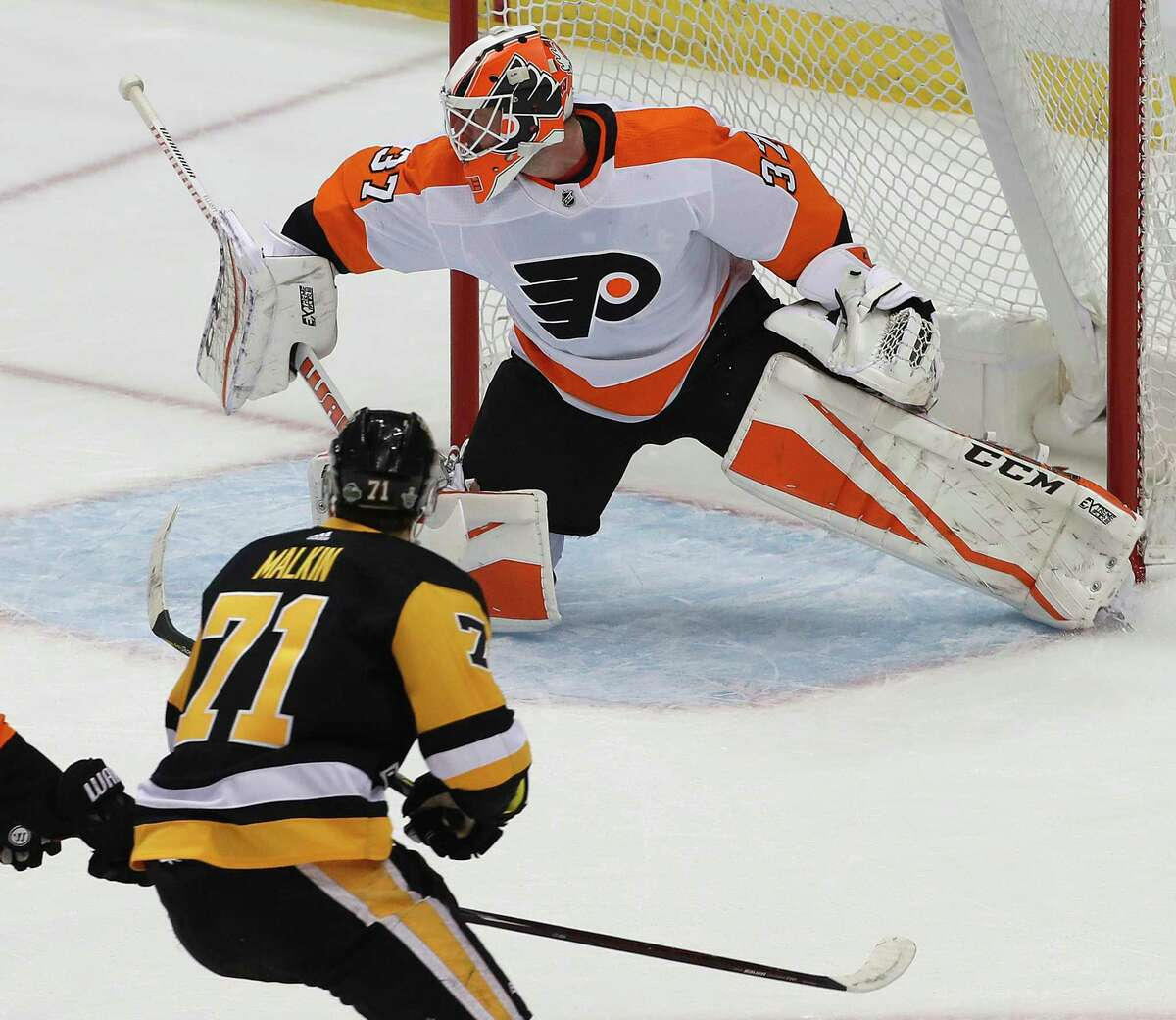 Pittsburgh Penguins' Evgeni Malkin (71) gets a shot behind Philadelphia Flyers goaltender Brian Elliott (37) for a goal during the first period in Game 1 of an NHL first-round hockey playoff series against the Philadelphia Flyers in Pittsburgh, Wednesday, April 11, 2018. (AP Photo/Gene J. Puskar)