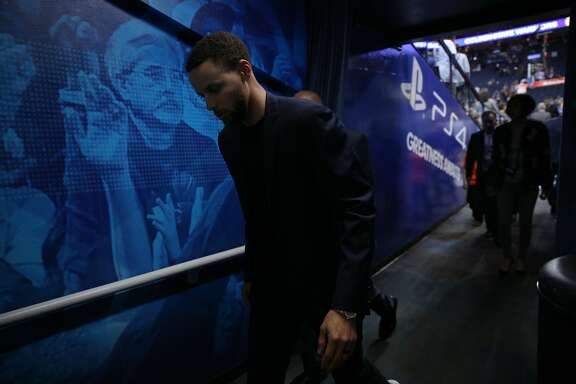 Golden State Warriors guard Stephen Curry (30) exits and follows the team to the locker room following an NBA game between the Warriors and New Orleans Pelicans at Oracle Arena on Saturday, April 7, 2018, in Oakland, Calif. The Warriors lost 126-120. Curry continues to recover and is on the injury list.