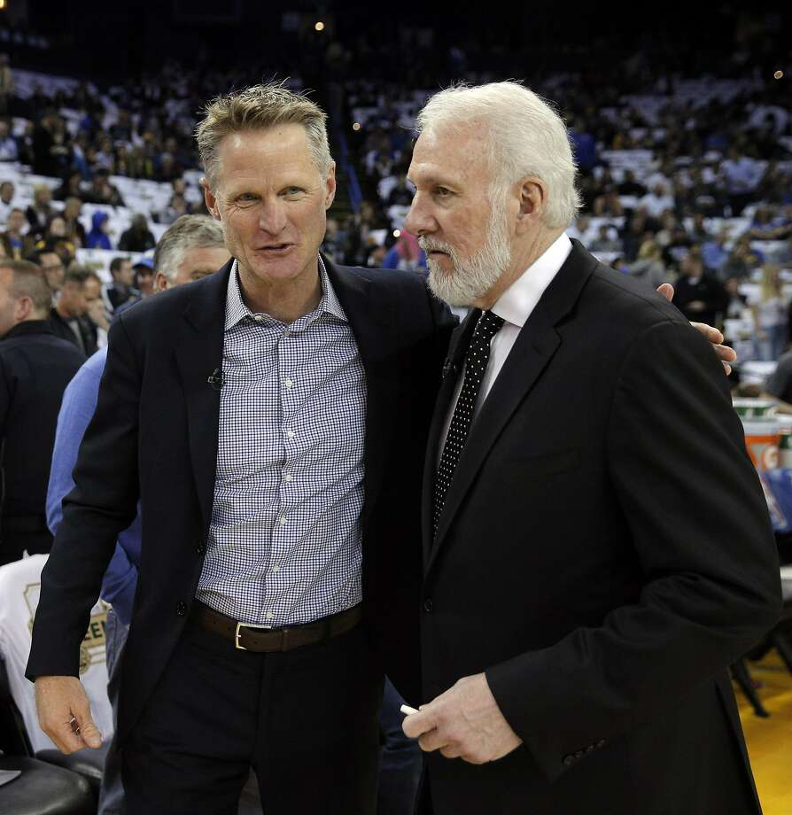 Steve Kerr and Gregg Popovich chat before a Spurs, Warriors game in 2018. Both, vocal critics of President Trump, have recently come under fire from the president's twitter account. FILE PHOTO Photo: Carlos Avila Gonzalez, The Chronicle