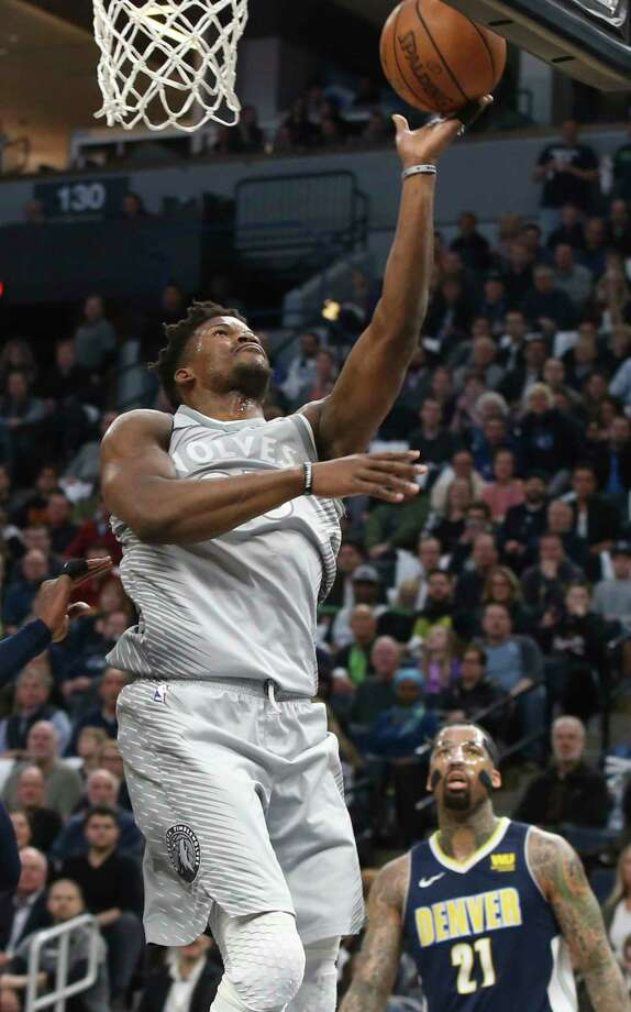 Minnesota Timberwolves' Jimmy Butler lays the ball up as Denver Nuggets' Wilson Chandler watches during the first half of an NBA basketball game Wednesday, April 11, 2018, in Minneapolis. (AP Photo/Jim Mone) Photo: Jim Mone / Copyright 2018 The Associated Press. All rights reserved.