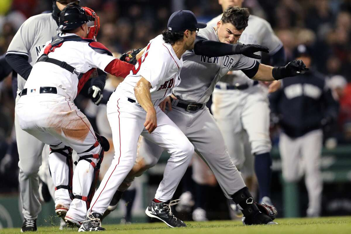 BOSTON, MA - APRIL 11: Tyler Austin #26 of the New York Yankees fights Joe Kelly #56 of the Boston Red Sox after being struck by a pitch Kelly threw during the seventh inning at Fenway Park on April 11, 2018 in Boston, Massachusetts. (Photo by Maddie Meyer/Getty Images)