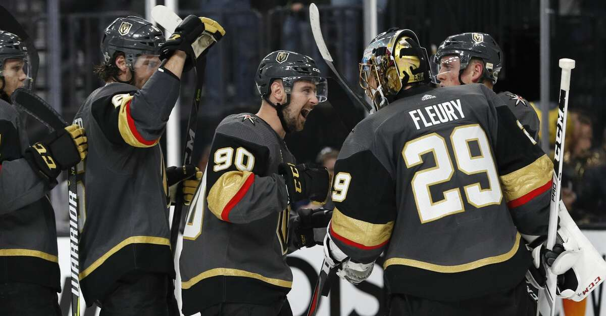 The Vegas Golden Knights celebrate after defeating Los Angeles Kings 1-0 in Game 1 of an NHL hockey first-round playoff series Wednesday, April 11, 2018, in Las Vegas. (AP Photo/John Locher)