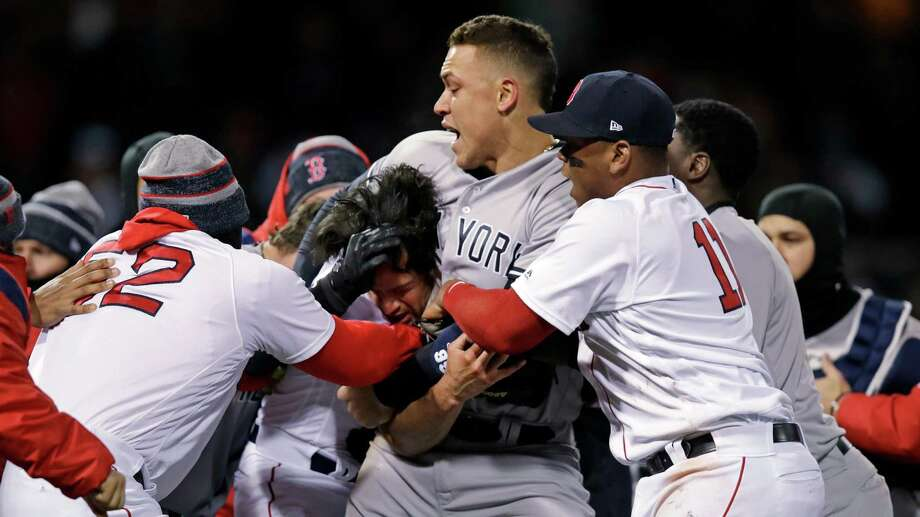New York Yankees right fielder Aaron Judge puts Boston Red Sox relief pitcher Joe Kelly in a headlock after Kelly hit Yankees' Tyler Austin with a pitch during the seventh inning of a baseball game at Fenway Park in Boston, Wednesday, April 11, 2018. (AP Photo/Charles Krupa) Photo: Charles Krupa / Associated Press / Copyright 2018 The Associated Press. All rights reserved.