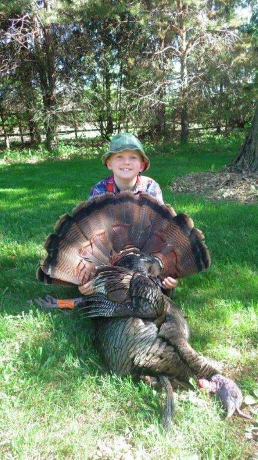 Zack Burnette shows a Thumb gobbler that was called into range by his father, Don. Zack used a Youth Model 1100 Remington 20-gauge with an extra full turkey choke and stoked with 23/4-inch copper-plated lead number fours. (Tom Lounsbury/Hearst Michigan)