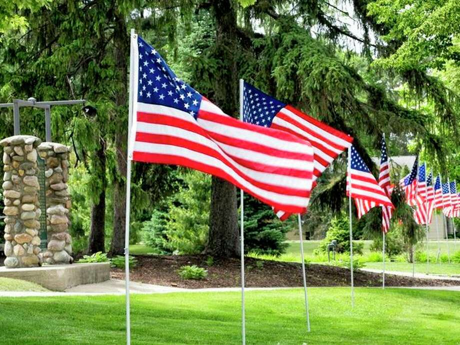 For the fifth year, Kiwassee Kiwanis Club of Midland will place 400 flags around Midland on five national holidays: Memorial Day, Flag Day, Fourth of July, Labor Day and Veterans Day. (Photo provided)