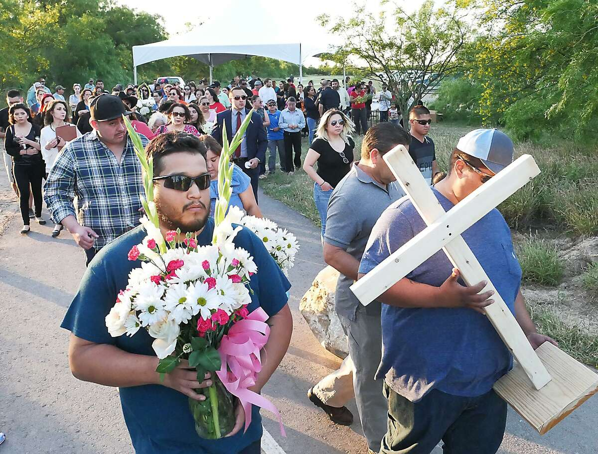 A candlelight vigil was held Wednesday at Father Charles M. McNaboe Park for the mother and child who were found slain Monday near the park.