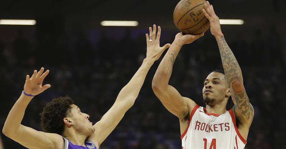Houston Rockets guard Gerald Green, right, shoots over Sacramento Kings forward Justin Jackson during the first quarter of an NBA basketball game, Wednesday, April 11, 2018, in Sacramento, Calif. (AP Photo/Rich Pedroncelli) Photo: Rich Pedroncelli/Associated Press