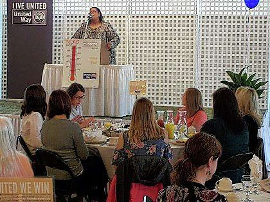 Tilde Holmes, CEO of the social service agency Community Childcare Service Association, tells a crowd gathered Wednesday for the Prairieland United Way annual awards and recognition breakfast about the impact United Way has had on the community. Photo:       David C.L. Bauer | Journal-Courier