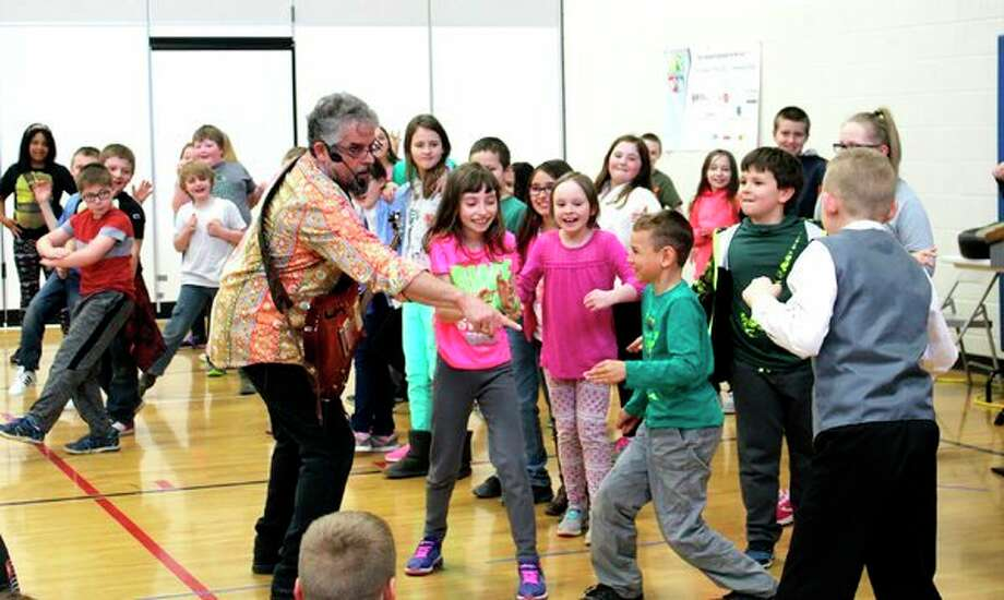 Guy Louis, a Michigan-based musician, visited Laker Elementary in late March for two events. One was an assembly where he taught students how deep breathing can have positive effects on the brain. For instance, deep breathing can calm one down in times of stress and frustration and it can help one go to sleep sooner. He had students play instruments and dance along to the music he played on his guitar. Louis interacted with the audience a lot, walking between students as he performed. That evening, he headlined the school's Family Fun Night. Once again, he had students play instruments and dance while he played music and sang. He also invited interested students to step up to the microphone and sing whatever song they wanted. The children had a great time. After Louis's performance, families participated in a variety of hands-on activities in the school hallways. They also could make their own healthy snack - lettuce wraps with the assistance of co-head cook Cinamon Marker. (Submitted Photo)