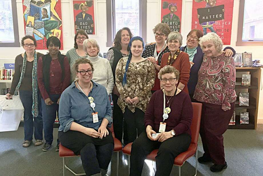 The staff and administration of Russell Library in Middletown marked National Library Workers Day Tuesday. Photo: Contributed Photo