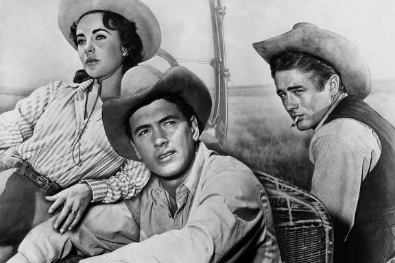 "Actors James Dean, Elizabeth Taylor and Rock Hudson pose for a composit photo on the set of the Warner Bros film ""Giant"" in 1955 in Marfa, Texas."