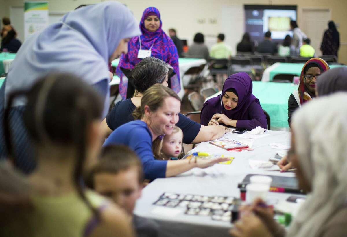 Fatima Yakub, 27, does a henna design on mosque guests during the Open Mosque Day at the Bear Creek Islamic Center, Saturday, March 10, 2018, in Houston. ( Marie D. De Jesus / Houston Chronicle )