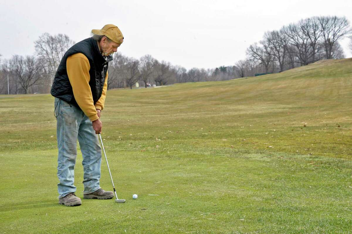 Jay Nickolaus of Troy works on his putting on the practice green at Frear Park Thursday April 12, 2018 in Troy, NY. (John Carl D'Annibale/Times Union)
